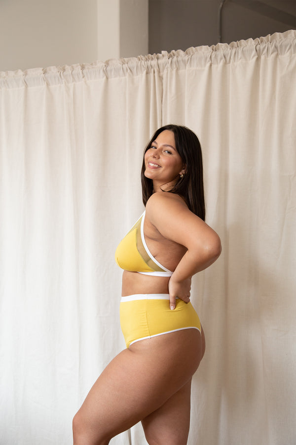 model posing in mary young bra and panty set in citrine