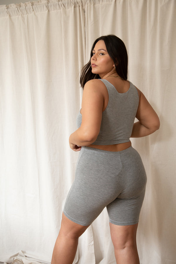 plus sized model posing in grey bamboo rayon lounge set