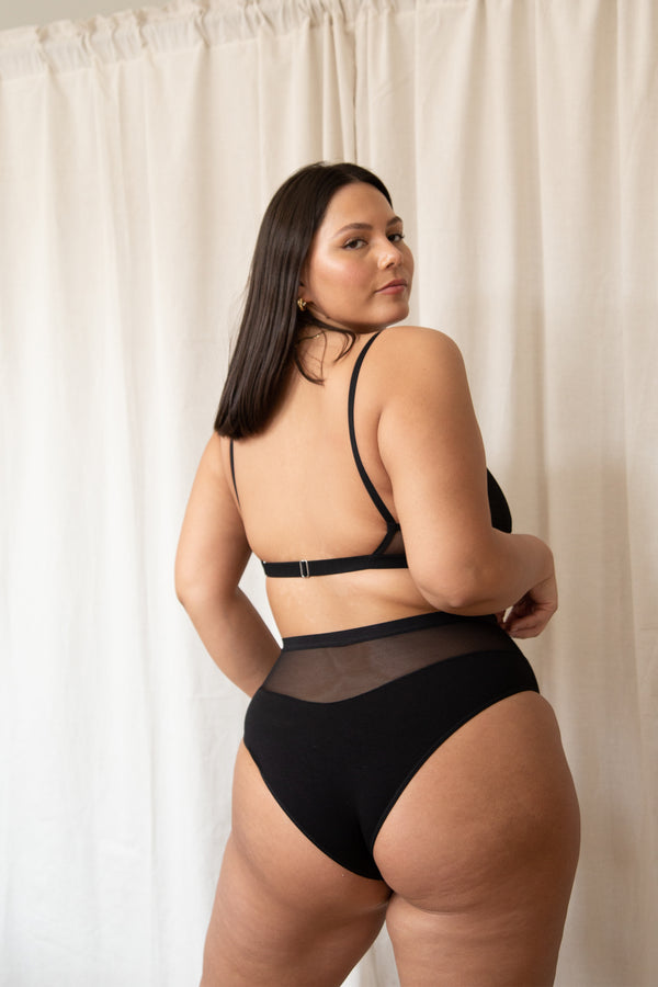 model posing in black high waist mesh and bamboo rayon bikini panty