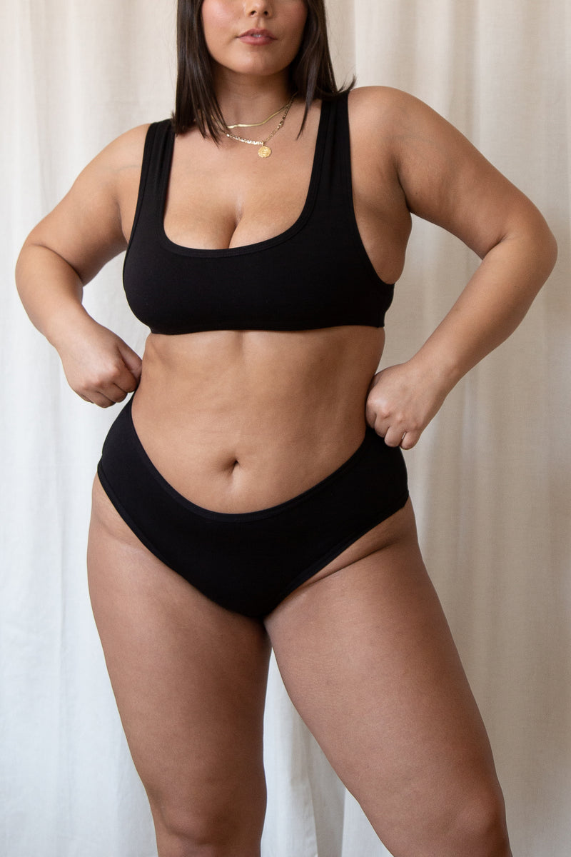 model poses in black scoop neck bra and bamboo rayon panties in black