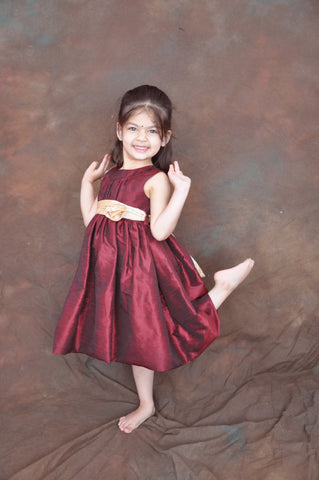 Burgundy flower girl dress with champagne sash