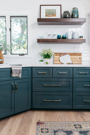 greige design shop + interiors kitchen with dark blue green cabinets and white counter tops laguan beach california design