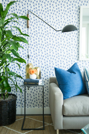 greige design shop + interiors pasadena interior design graphic wallpaper blue and white swing arm wall sconce