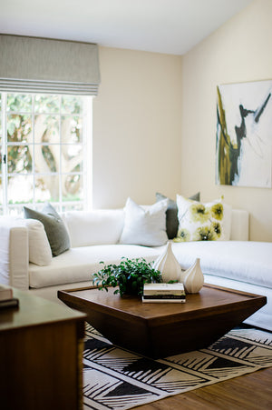 greige design shop + interiors dana point beach house california designer white sectional sofa graphic rug and wood coffee table