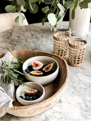 greige design shop + interiors handmade pottery seagrass wraped glasses