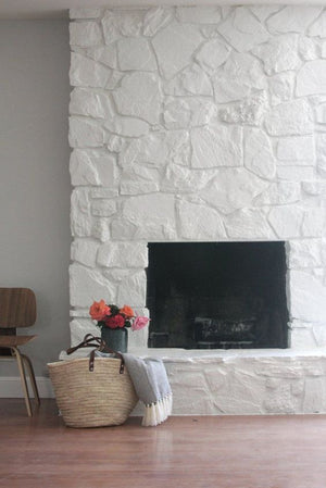 greige design shop + interiors paiting the stone fireplace white