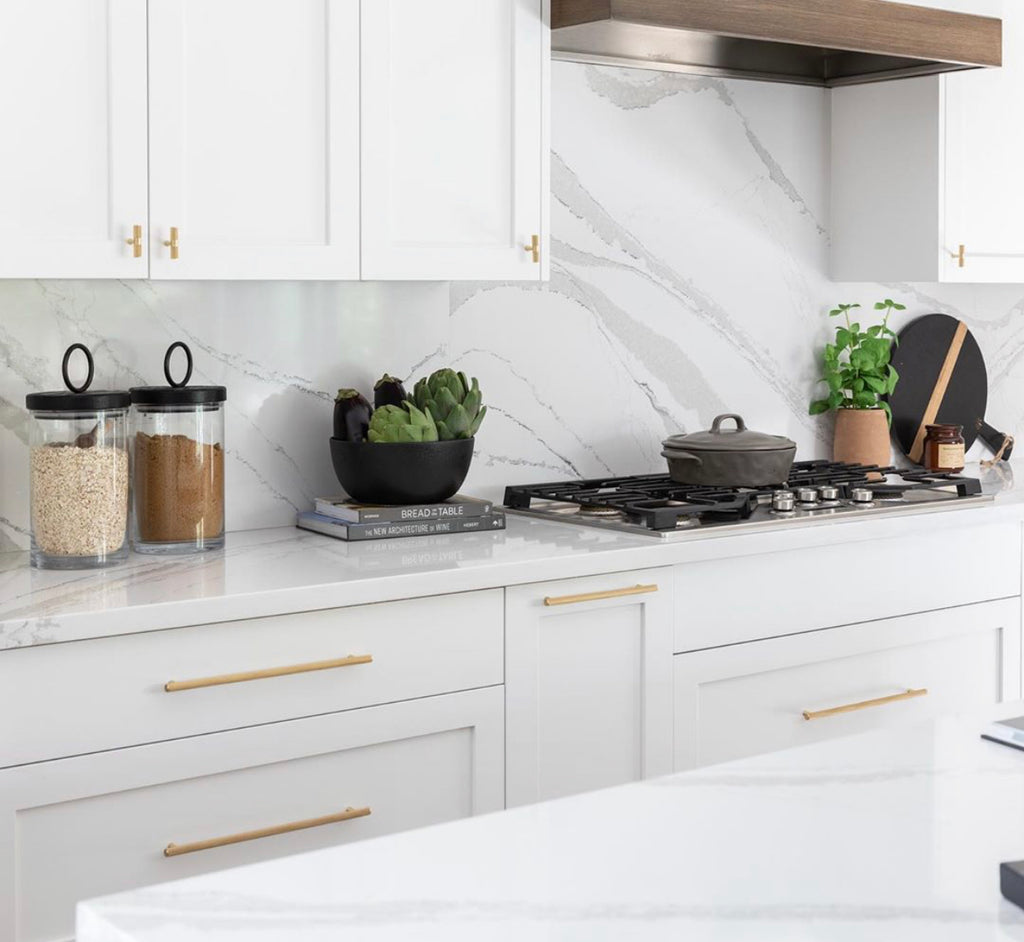 @cabanarehabinteriors kitchen white with gold hardware
