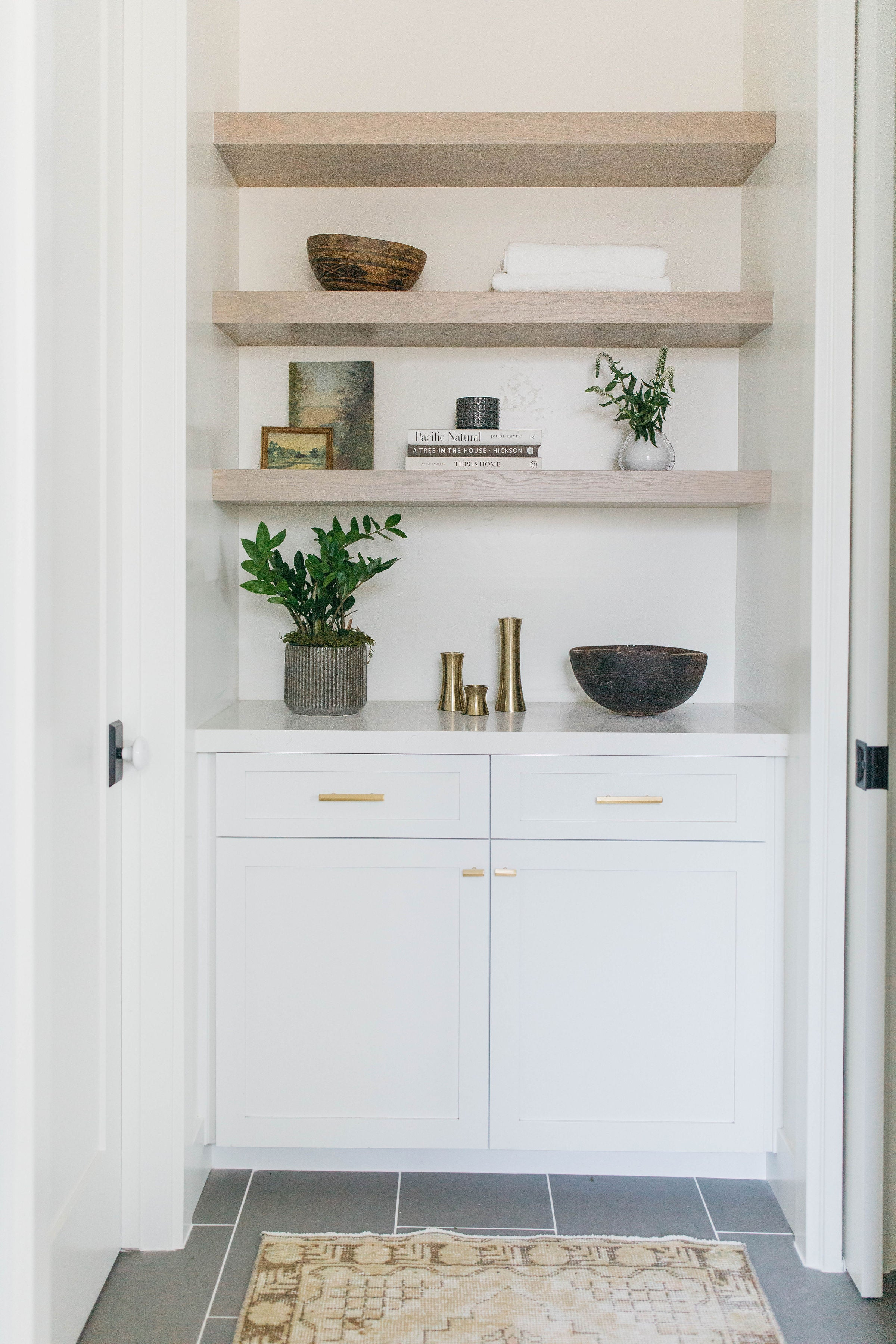 Albion project greige design shop + interiors Point Loma San Diego California interior design master bathroom open shelves linen closet