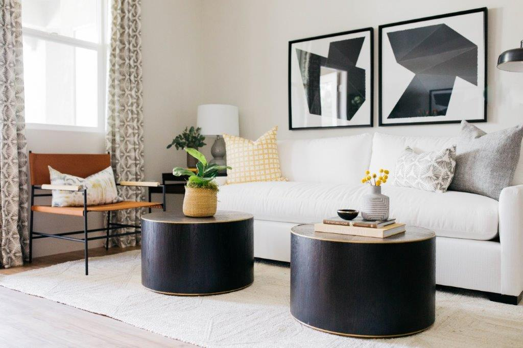 greige design shop + interiors living room round gathering tables white sofa greige textiles felix and cie fabric