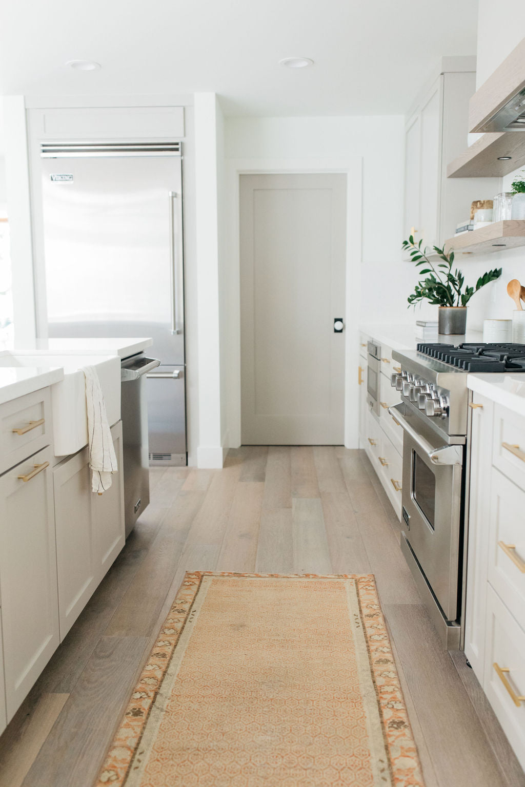 greige design shop + interiors alexandria project kitchen grey cabinets vintage runner open shelves