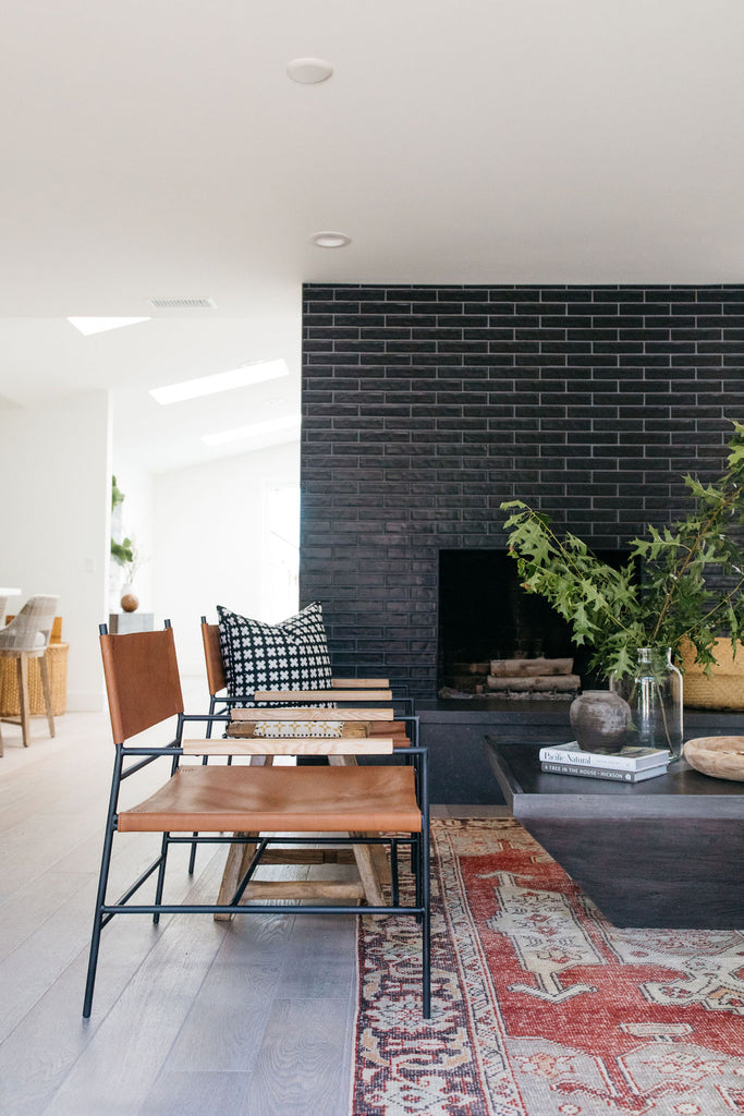 greige design shop + interiors alexandria project san diego california beach house black stacked tile fireplace living room design