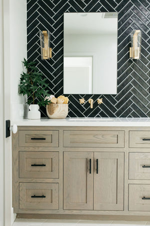 greige design shop + interiors alexandria project san diego california beach house black herringbone backsplash brass fixtures master bathroom design