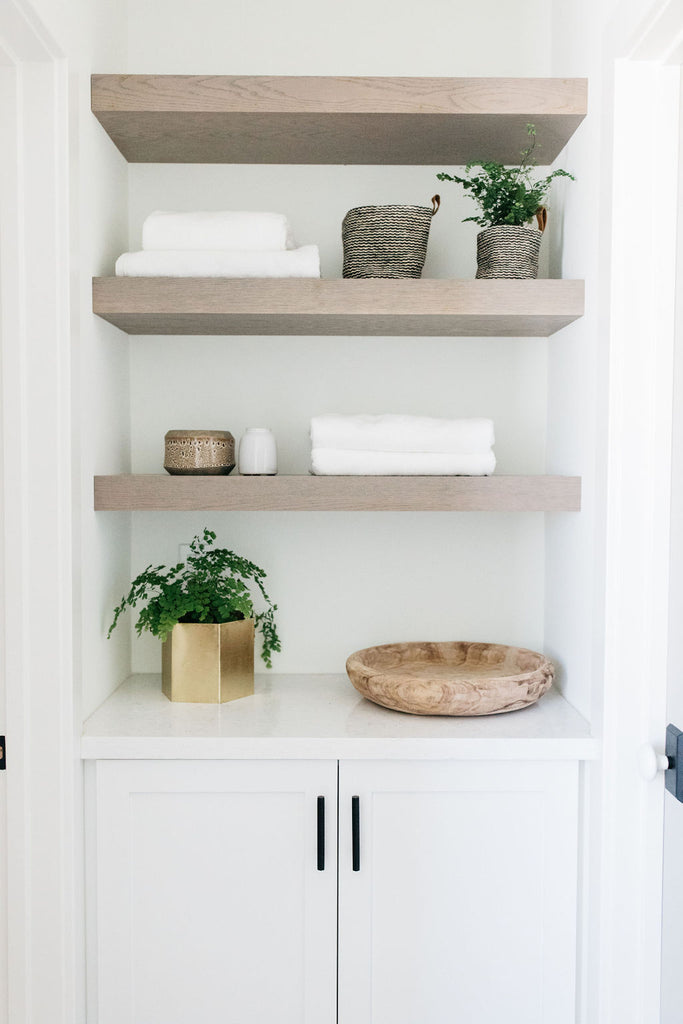 greige design shop + interiors alexandria project san diego california beach house linen storage open shelves  master bathroom design