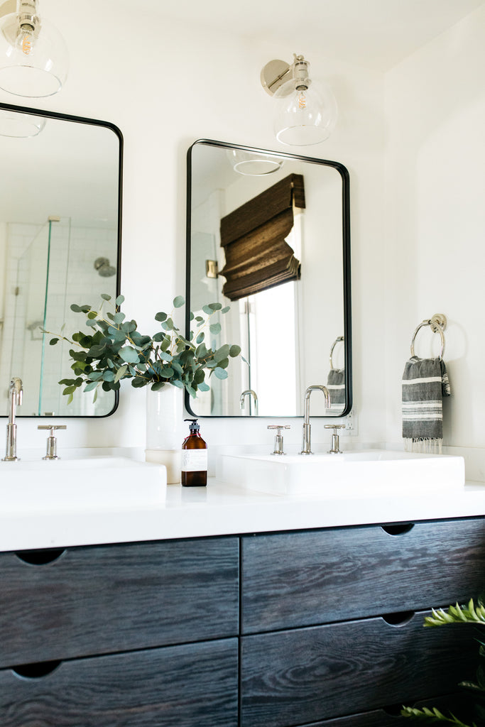 Bright white modern California Coastal retreat bathroom by greige design shop + interiors in Laguna Beach, Ca.
