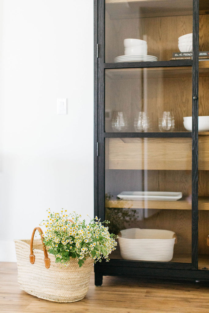 greige design shop + interiors black miles storage cabinet dining room design