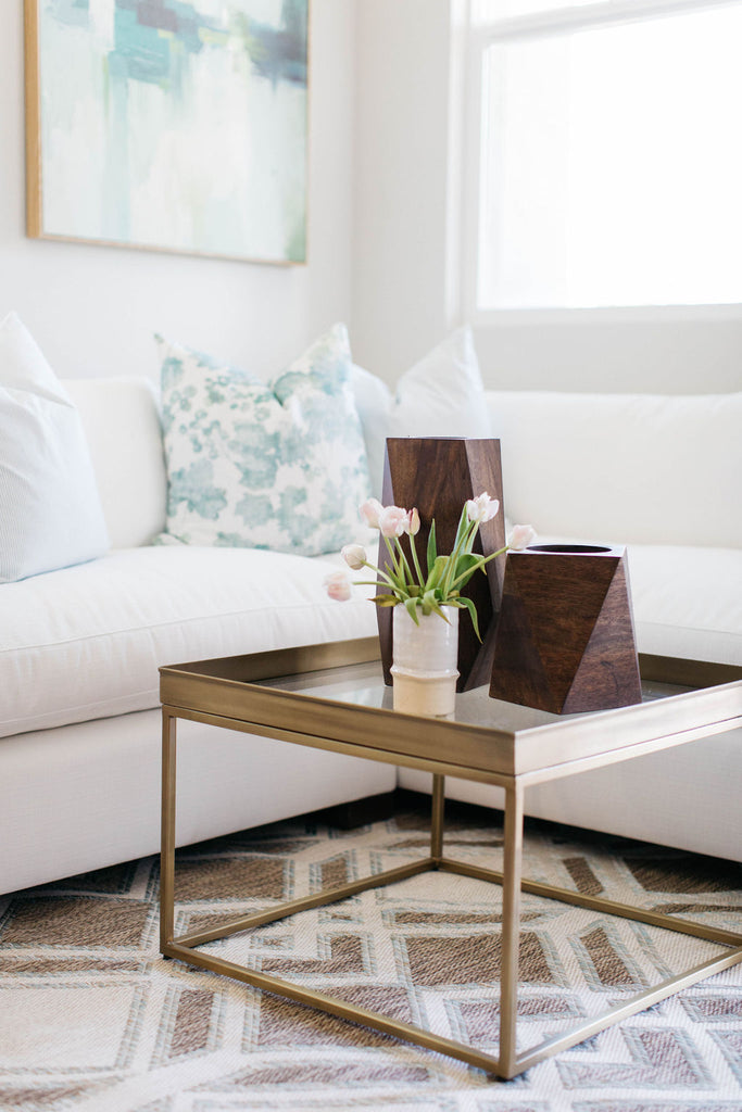 greige design shop + interiors  white sofa california style Orange County brass bunching tables