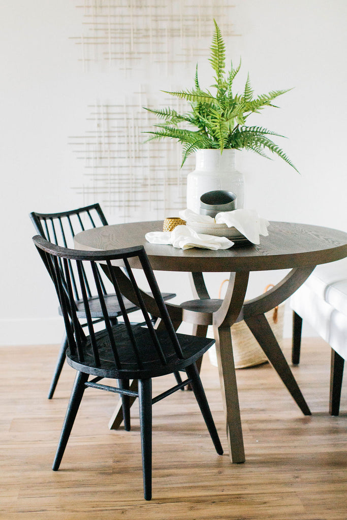 greige design shop + interiors living room round dining table black spindle dining chair