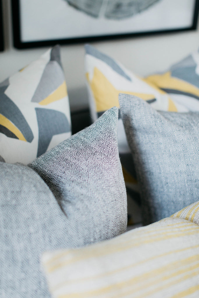 greige design shop + interiors greyg and yellow bedroom pillows kravet fabrics greige textiles texture Nick fabric