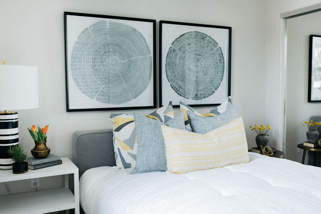 greige design shop + interiors bedroom Grey and yellow with grey uphostlered bed black and white striped lamp