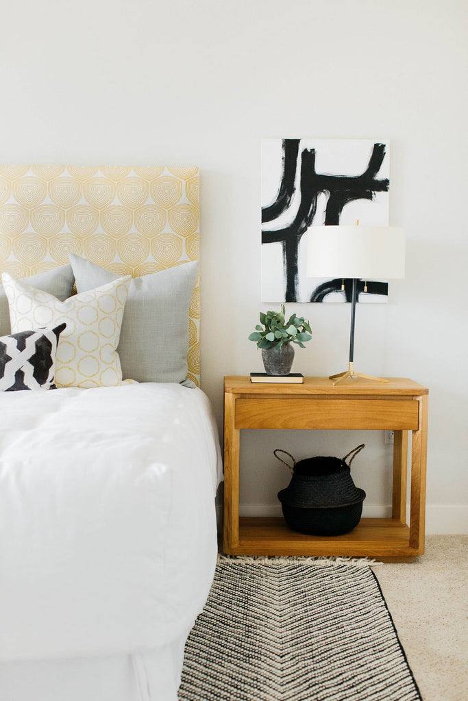 greige design shop + interiors l greige textiles ward and cape custom upholstered headboard black and white art