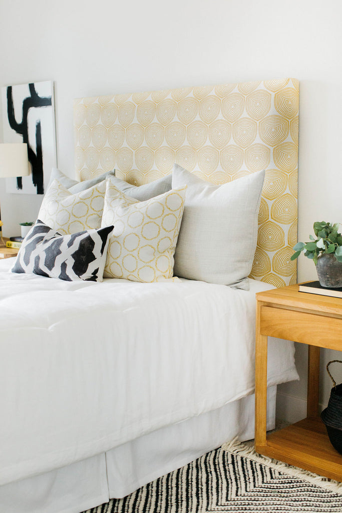 greige design shop + interiors greige textiles headboard ward on wheat with cape pillows open teak nightstand