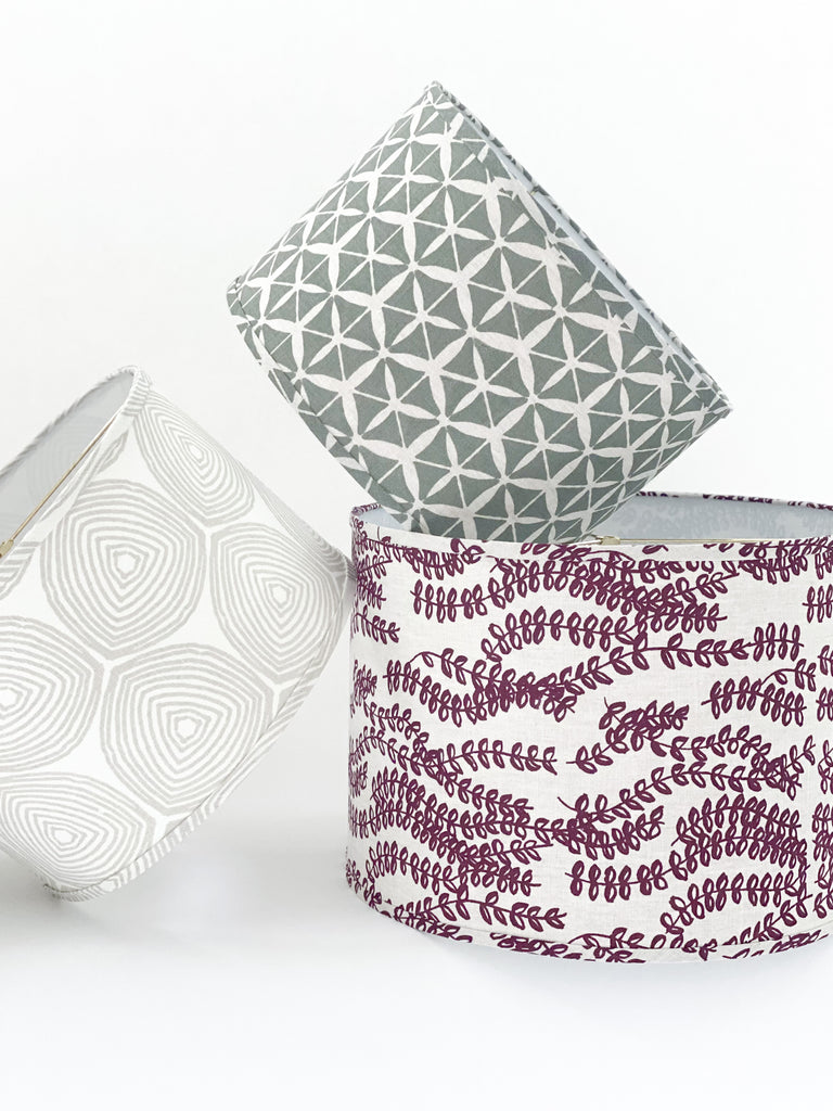 Ward in Heron on Oyster, Tule Moss on Oatmeal, and Antoinette in Ruby on Oatmeal custom lampshade greige design made in USA