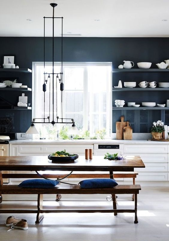 love love the deep blue on the walls of this kitchen everything is