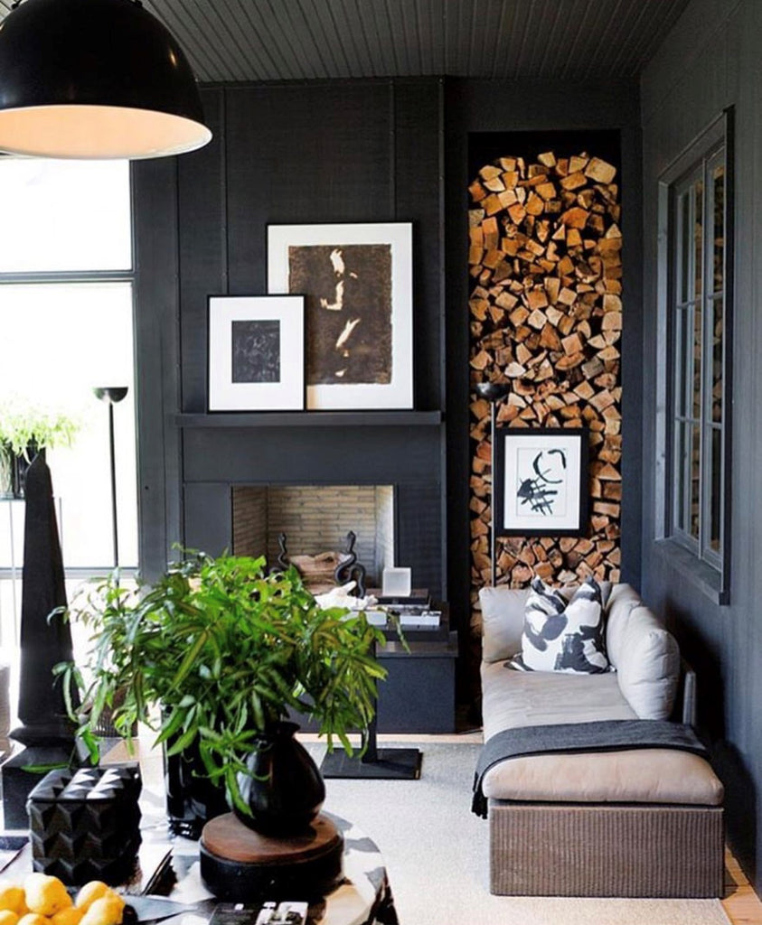 Instagram round up greige design shop + interiors blog black painted walls stacked firewood niche  dark interiors