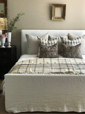 Off white & Chestnut wool bedcover hand woven in India greige design shop + interiors boho chick interior design slipcoved bedframe white linen