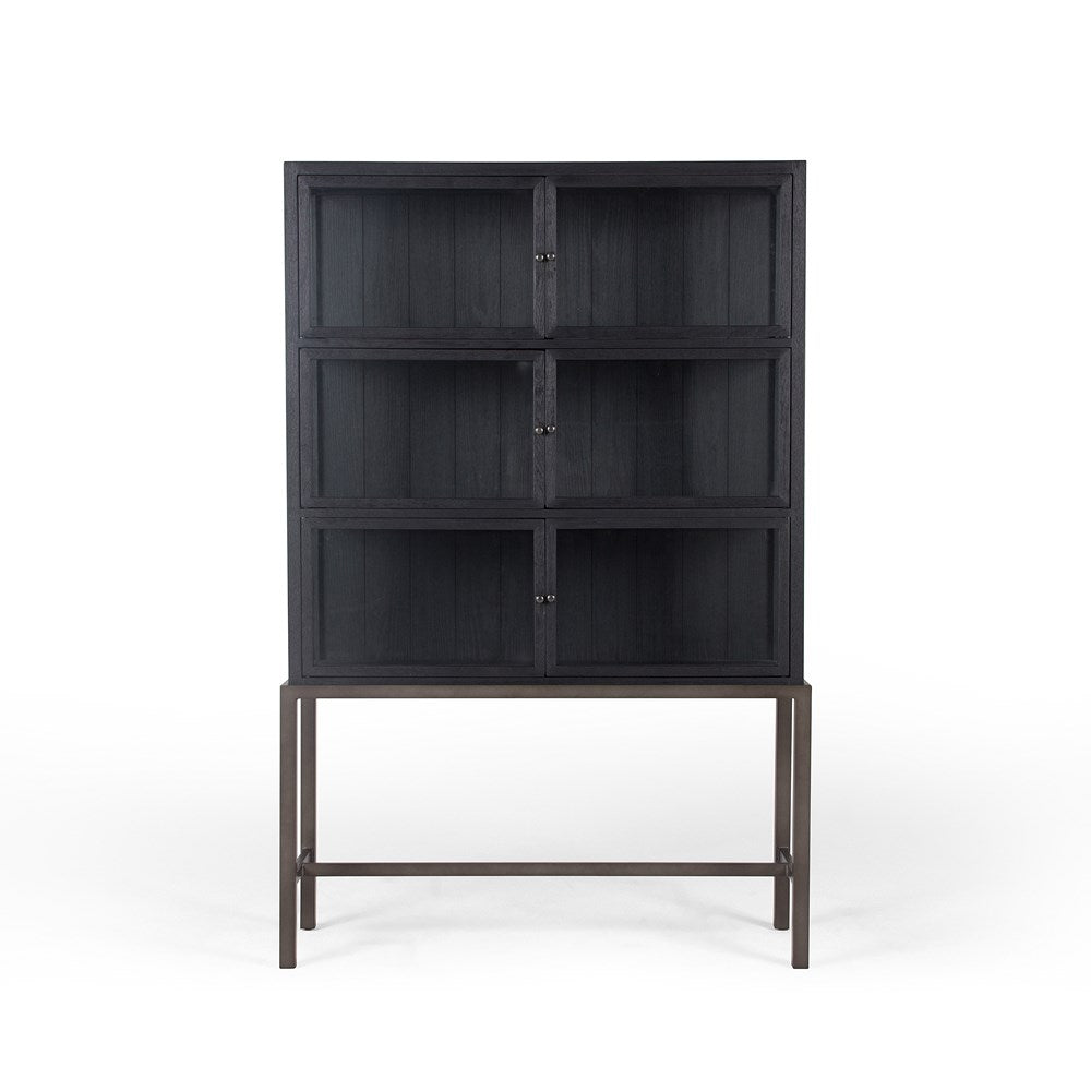 black oak cabinet on metal base with glass doors