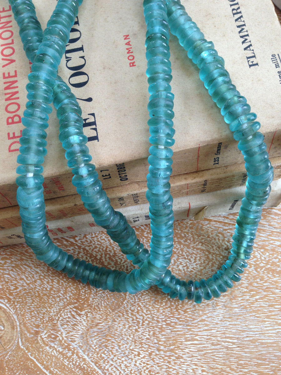 Turquoise glass mini disc beads