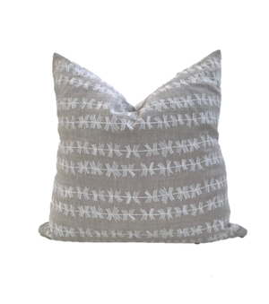 Stick stripe pillow in white on Oatmeal