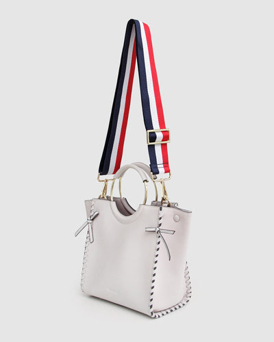 Belle-&-Bloom-cream-leather-basket-golden-ring-webbing-strap.jpg
