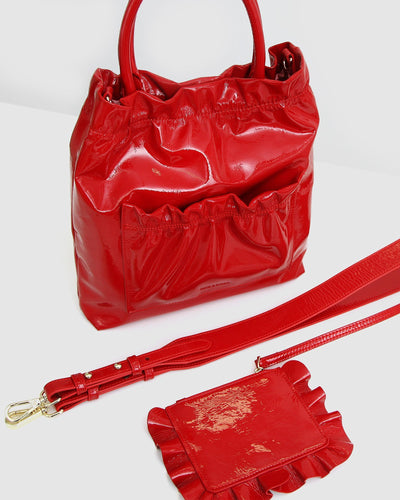Red-leather-bag-shiny-cross-body-pouch-straps.jpg