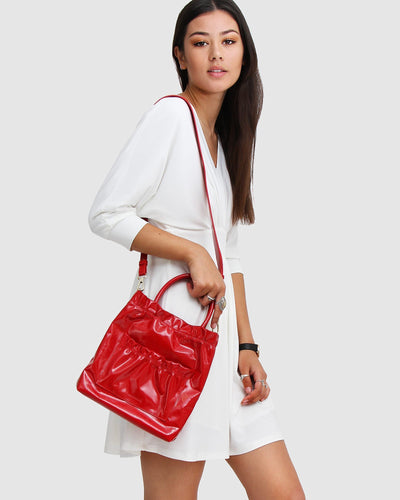 Red-leather-bag-shiny-front-pocket.jpg