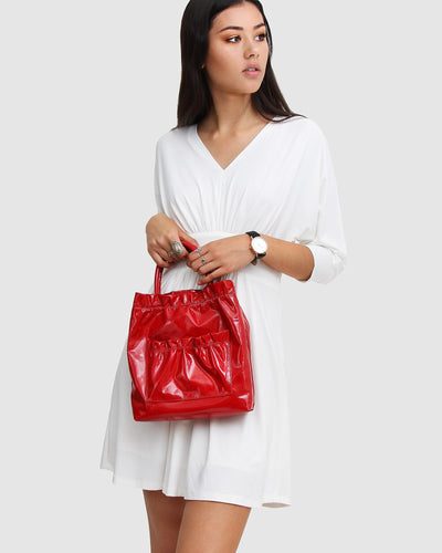 Red-leather-bag-shiny-handle.jpg