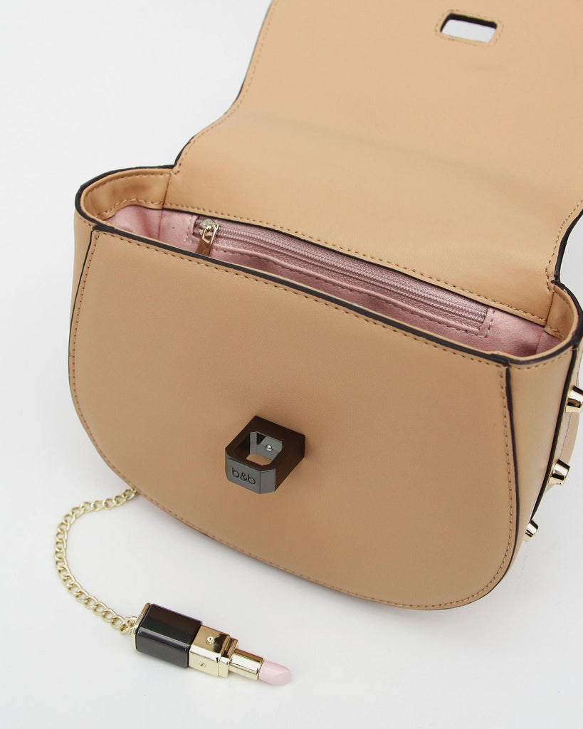 Tan-leather-cute-bag-with-pink%20lining.jpg