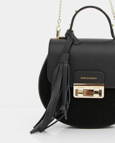 black-leather-and-suede-bag-with-lock-drtail-and-tassel.jpg