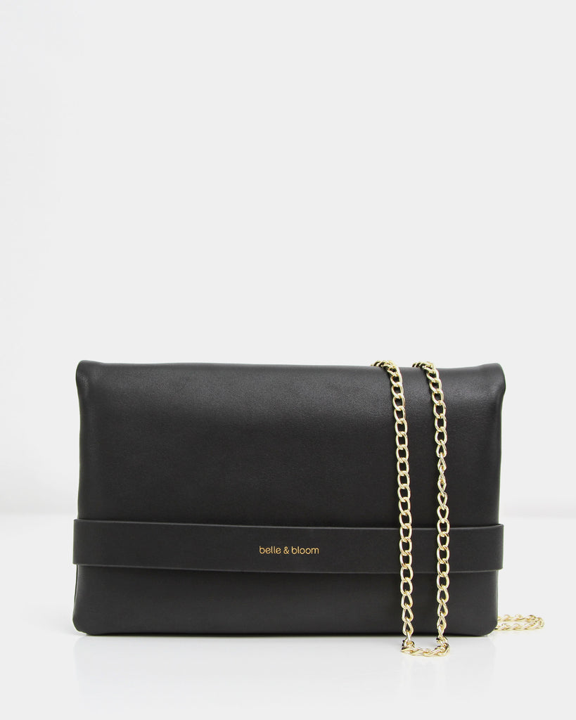 black-leather-clutch-with-golden-crossbody-chain.jpg