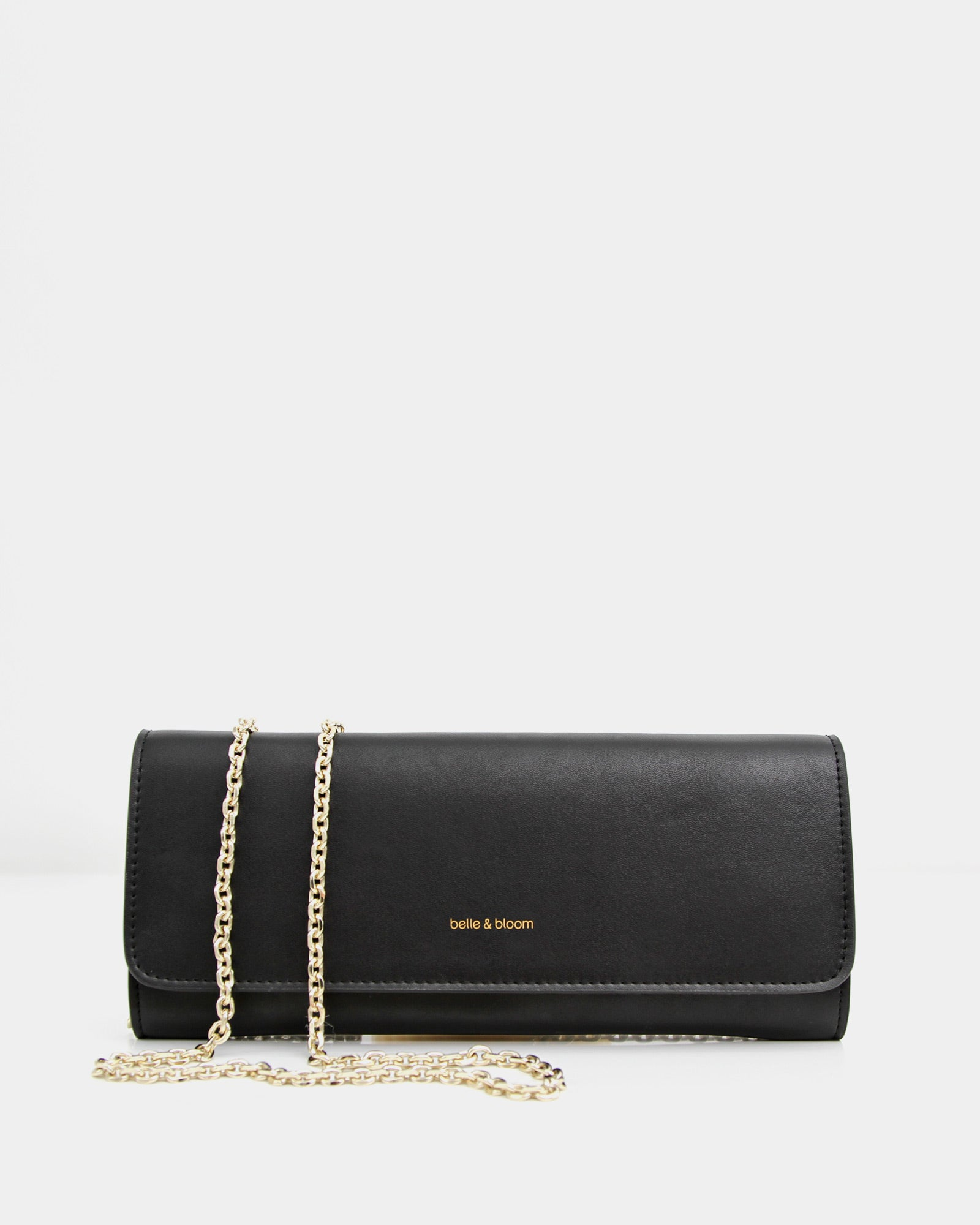 black-leather-clutch-with-golden-crossody-chain.jpg