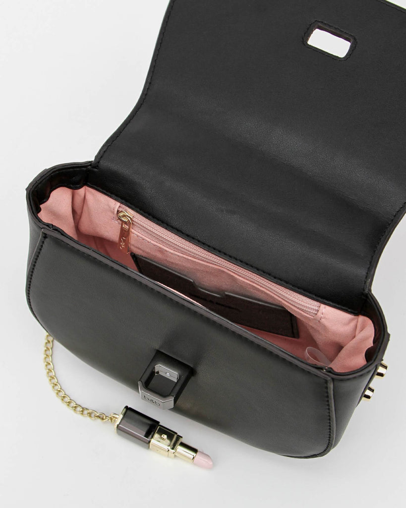 black-leather-cute-bag-with-pink-lining.jpg