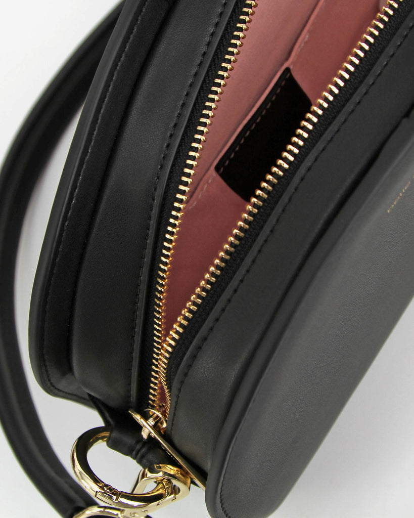black%20leather%20crossbody%20half%20moon%20pink%20lining.jpg