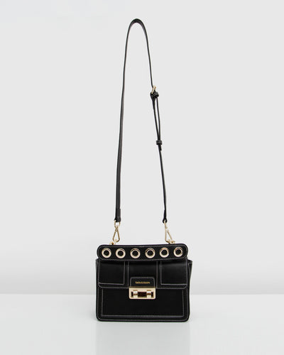 black%20leather%20crossbody%20with%20golden%20hardware.jpg