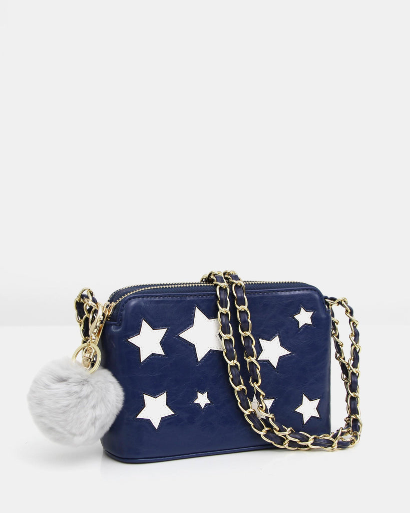 blue-leather-starry-bag-with-pom-pom-gift.jpg