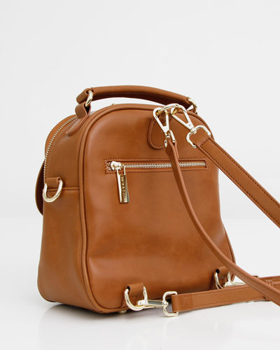 brown-leather-back-pack-gold-hardware.jpg