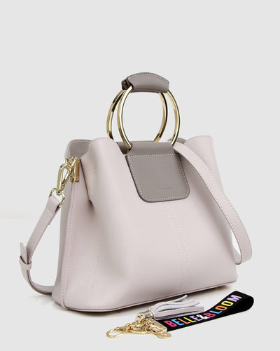 cream-and-grey-leather-handbag-with-detachable-keychain.jpg