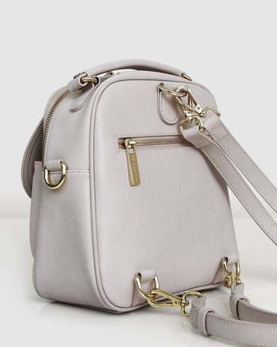 cream-leather-back-pack-gold-hardware-back-zipper.jpg