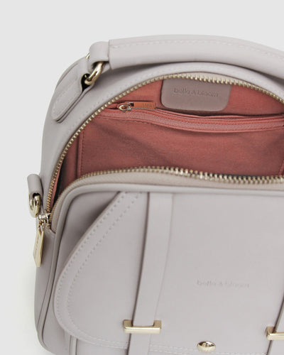 cream-leather-back-pack-gold-hardware-inside-pocket.jpg