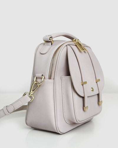 cream-leather-back-pack-gold-hardware-side.jpg