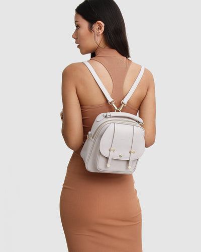 cream-leather-backpack-gold-hardware-back-model.jpg